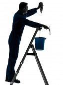 one caucasian man house worker janitor cleaning window cleaner silhouette in studio on white backgro
