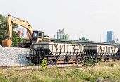 stock photo of railroad yard  - Rock freight train in the railway yard for maintenance the new railroad - JPG