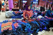 Woman from Black H'mong minority tribe selling textile in Bac Ha market, Vietnam