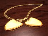 pic of table manners  - beautiful golden pendant in the manner of heart lying on table - JPG