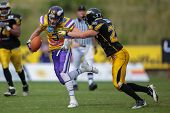 VIENNA, AUSTRIA - JUNE 17 WR Kyle Kaiser (#3 Vikings) is tackled by DB Mario Schmitt (#27 Adler) on
