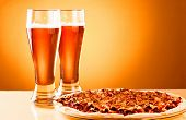 foto of take out pizza  - Two glass of beer and pizza over yellow background - JPG