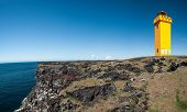 Small lighthouse on the cliff at Snaefellsnes, the western of Iceland. Panoramic photo with Snaefell