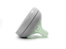 stock photo of teats  - Green Baby bottle rubber teat - JPG