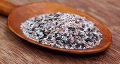 Medicinal Herbs Isabgul And Basil Seeds On A Wooden Spoon