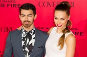 LOS ANGELES, CA - NOVEMBER 18: Singer Joe Jonas and Model Blanda Eggenschwiler arrive at the premier