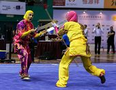 KUALA LUMPUR - NOV 05: Members of the Iranian dalian team performs a fight scene in the Women's Dual