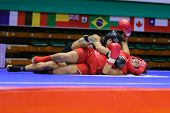 KUALA LUMPUR - NOV 03: Equador's Maria Quispe (red) downs Italy's Antonia Di Biase in the Women's 'S