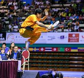 KUALA LUMPUR - NOV 03: Brazil's Henry Yuji Nakata executes a high kick in the Men's 'Daoshu' Event at the 12th World Wushu Championship on November 03, 2013 in Kuala Lumpur, Malaysia.