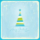 Illustration of a stylized Christmas tree on pale blue grunge background. Space for your text.