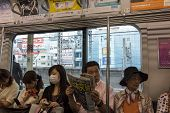 Passangers In A Tube Carriage In Tokyo, Japan.