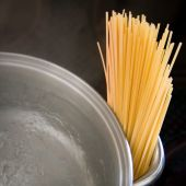 Dry Spaghetti With Boiling Water And Dark Background poster