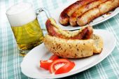 stock photo of hot dog  - Hot dog mug of beer and grilled sausages - JPG