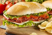 stock photo of salami  - Homemade Italian Sub Sandwich with Salami Tomato and Lettuce - JPG