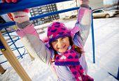 Happy girl in winterwear having fun outside