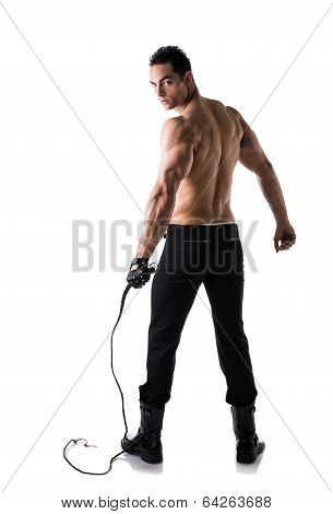 Muscular Shirtless Young Man With Whip And Studded Glove poster