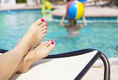 stock photo of wet feet  - Beautiful Feet and toes by the swimming pool - JPG
