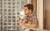Hipster Guy Smoking Cigarette And Drinking Coffee