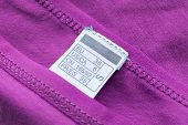 foto of knitwear  - Purple knitwear cloth with white international size label - JPG