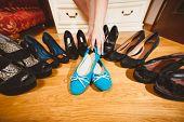 Woman Picking Ballet Flats Rather Than High Heels