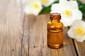 foto of jasmine  - Jasmin essential oil with jasmine flowers on wooden table background - JPG