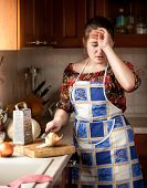 Housewife Crying While Cutting Onion