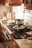 picture of saucepan  - Closeup photo of metal saucepan boiling on stove - JPG