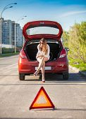 pic of dangerous situation  - Lonely depressed woman sitting on trunk of broken car - JPG