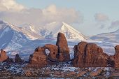 foto of turret arch  - Turret Arch with Snow Mountains at Sunset - JPG