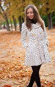 Beautiful Young Woman In Polka Dot Trench At Fall