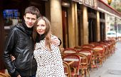 Young Romantic Couple In Paris, Near A Street Cafe