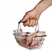 Man's hand holding a Money Rubles of the Russian Federationin your shopping  basket cart  isolated o