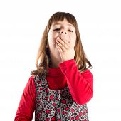 Young Girl Yawning Over Isolated White Background