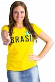 Pretty football fan in brasil t-shirt on white background