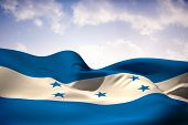 Honduras flag waving against beautiful blue sky