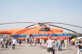 People explore the MI-6A helicopter