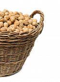 Walnuts In Wicker Basket Isolated