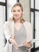 business concept - lovely woman with an open hand ready for handshake