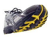 Running Shoe With Yellow And Black Tread Pattern Tilted Up