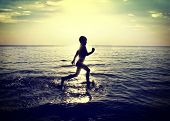 Child Running On The Water