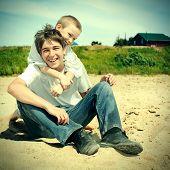 Happy Teenager And Kid Outdoor