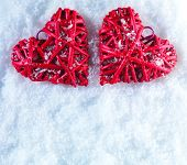 Hearts on the snow. Beautiful romantic vintage red hearts on a white snow background. Love, Christmas and St. Valentines Day concept.