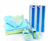 Baby clothes and gift bag isolated on white