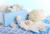 Sanitary pads in box and sanitery pads and white flowers on blue calendar on light blue background
