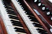 picture of pipe organ  - An old pipe organ keyboard in a church - JPG