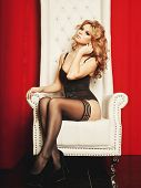pic of throne  - sensual princess woman in black lingerie sitting on throne - JPG