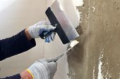 The Process Of The Concrete Wall Putty Two Spatulas