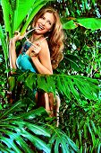 Happy beautiful young woman in bikini in the rainforest. Vacation. Tropics.