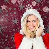 Pretty girl smiling in santa outfit against red vignette