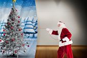Santa pulls something with a rope against room with wooden floor